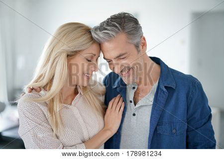 Portrait of loving middle-aged couple