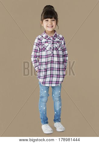 Young girl with a bun smiling full body portrait