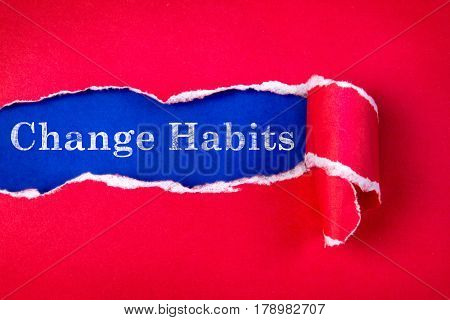 Torn red Paper and Change Habits text with a blue paper background