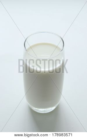 A Glass Of Milk On The White Background.