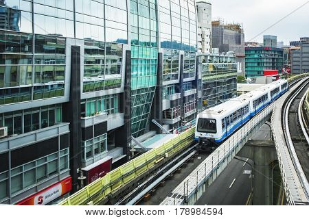 Taipei Taiwan - May 01 2016 : Street view of Taipei with metro train on the rail on May 01 2016 in Taipei Taiwan. the Taipei MRT is one of the best way to travel around the city.