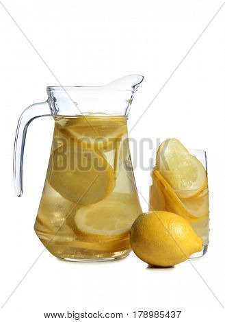 Lemon juice in a glass goblet on a white background