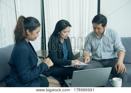 Pretty business interns listening to their team leader.