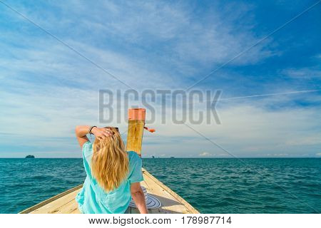 Young woman traveler on longtail boat trip at island hopping  Thailand