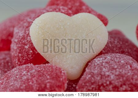 White Gummy Heart Of Pile Of Red Gummy Hearts
