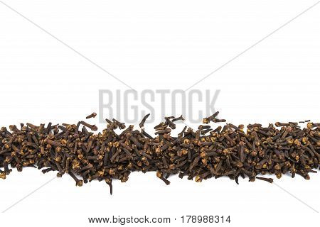 Whole Cloves In Row On Isolated White