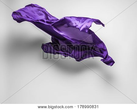 abstract piece of purple fabric flying, art object, design element