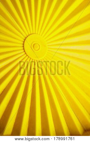 Yellow radiant background, center with radiating lines to the edge