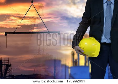 Construction concept . engineer  holding helmet and blur construction background . Occupational health and safety .