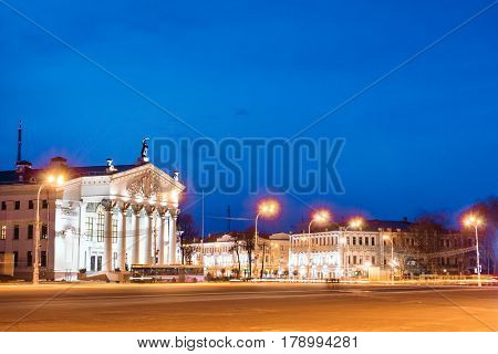 Lenin Square with the structure of drama theater in the evening with night illumination enabled the city and the blue sky in the background