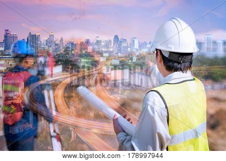 Double exposure construction engineer holding construction drawing with foreman worker checking construction site for new expressway Infrastructure for transportation project
