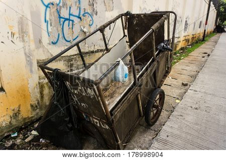 an abandon unmaintained cart for carrying garbage park on side the street photo taken in Jakarta Indonesia java