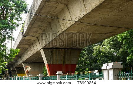 fly over for railway with trees and fence below the flyover photo taken in Jakarta Indonesia java