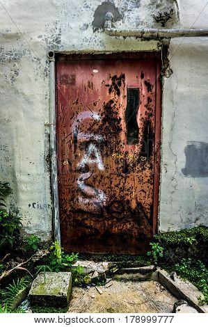 an abandoned old and grunge door with red colour photo taken in Jakarta Indonesia java