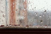 Window glass with increased condensation level strong high humidity in the room large drops of water flow down the window natural drops of water on the window glass textures of water droplets poster