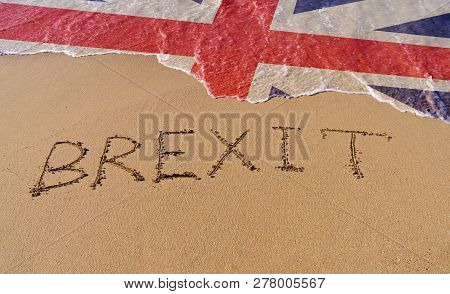 Handwrite text Brexit on sand coastline and foam wave with Great Britain flag pattern. On referendum, voted to exit United Kingdom from EU knows as Brexit, which is expected on March 29, 2019 poster
