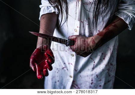 Ghost woman holding knife for kill a herself with in house. Horror. Halloween.horror of scary fear on hell is monster devil girl in halloween festival concept poster