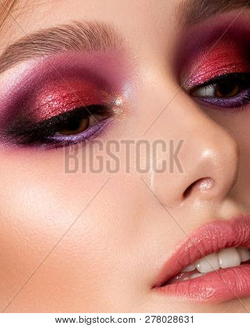 Closeup Portrait Of Young Beautiful Woman With Bright Pink Smokey Eyes And Lips. Fashion Makeup. Stu