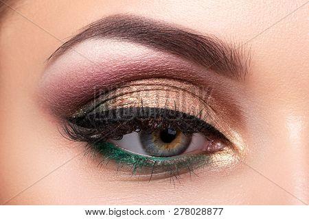 Close Up Of Beautiful Woman Eye With Multicolored Smokey Eyes Makeup. Modern Fashion Make Up. Studio