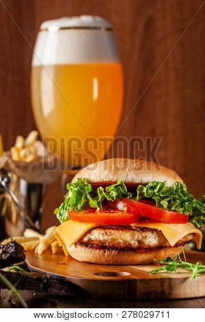 American Cuisine Concept. Juicy Burger With Meat Patty, Tomatoes, Cheddar Cheese, Lettuce And Homema