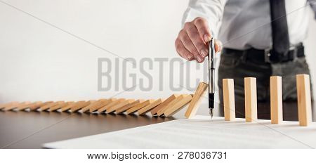 Chain Reaction In Business Concept, Businessman Intervening Chain Dominos Toppling By Signing A Cont