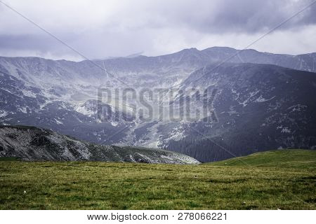 Landscape With Mountains, Green Hills And Cloudy Sky, Transalpina Road, Romania.