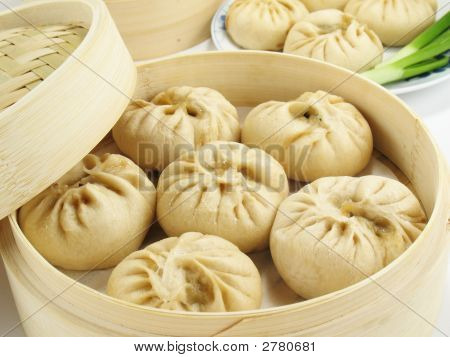 Baozi are steamed buns filled with ground meat and cabbage. poster