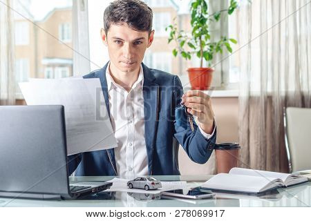 Agent Passes The Car Keys And Documents To The Car To The Client. Concept Of Buying Selling And Rent