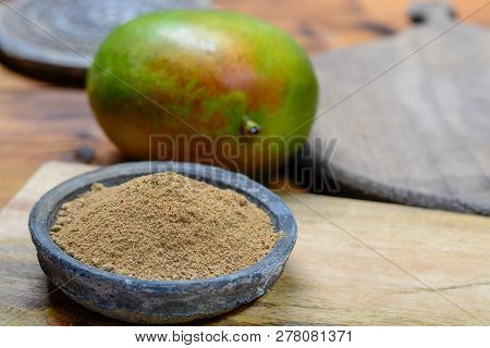 Amchoor or aamchur, mango powder, fruity spice powder made from dried unripe green mangoes in India, used to flavor foods close-up poster