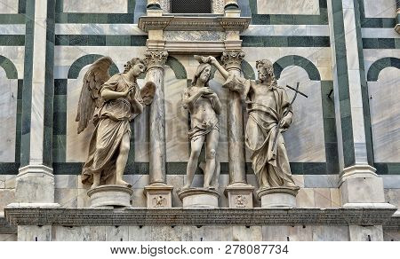 Baptizing. Medieval Art. Architectural Details Of The Baptistery Of Saint John, Which Is One Of The