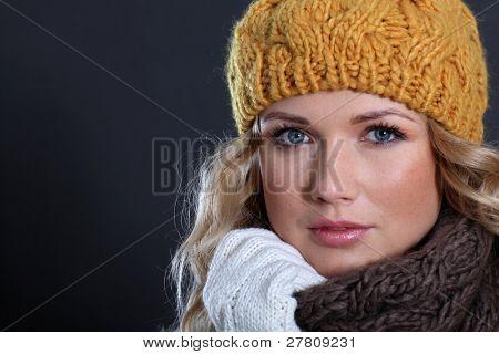 Portrait of beautiful woman wearing winter accessories poster