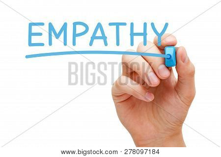 Hand Writing The Word Empathy With Blue Marker On Transparent Wipe Board Isolated On White.