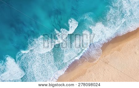 Beach And Waves From Top View. Turquoise Water Background From Top View. Summer Seascape From Air. T