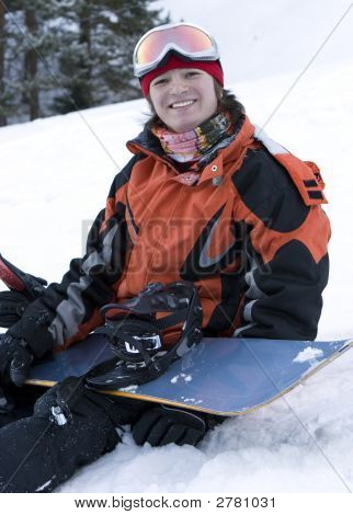 A Health Lifestyle Image Of Young Adult Snowboarder