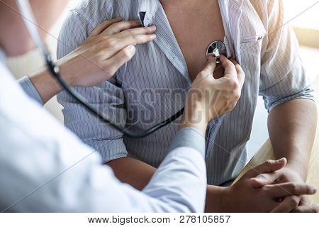 Doctor Using A Stethoscope Checking Patient With Examining, Presenting Results Symptom And Recommend