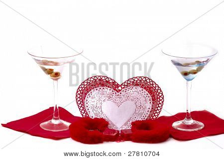 image depicting the concept Caught in love. Lace doilie hearts and furry handcuffs and Martini's