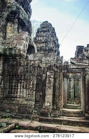 Stone Gate Of Angkor Thom In Cambodia, Siem Reap Angkor
