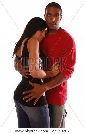 African American couple standing in an intimate and tender embrace