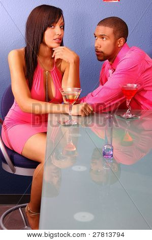 African American couple in a martini bar