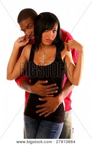 African American couple standing in an intimate and sexy embrace