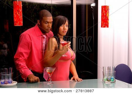 African American couple in a martini bar.