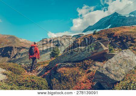 Backpacker Trailhead Hike. Caucasian Men On A Journey.