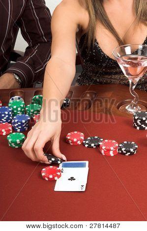 Woman placing a blackjack bet Card backs are a digitally created design