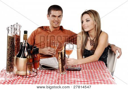 Beautiful and sexy woman and a handsome man enjoying a glass of wine at their favorite Bistro