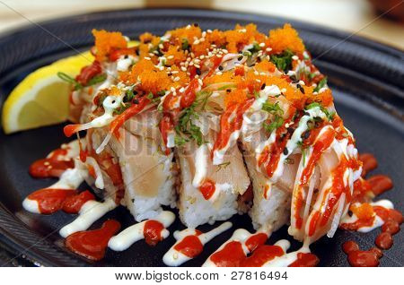 Tataki Special Sushi Roll. Spicy tuna in sushi rice with seared albacore, chopped onions, smelt roe, chili and mayonaise sauce poster