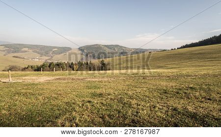 Autumn Landscape With Meadows, Hills Of Javorniky Village, Forest, Papradno Village And Blue Sky In