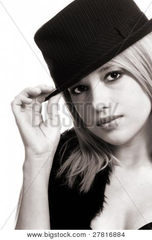 Full body shot of a beautiful young blond pop star in a black fur vest, bra, fedora