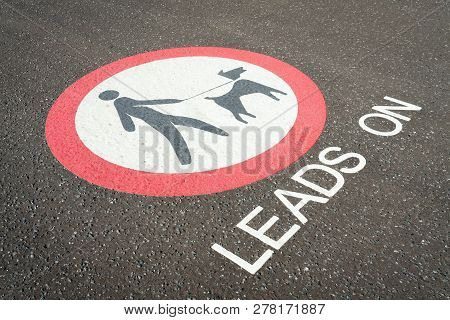 Dogs Allowed On Lead Sign In Public Area. Painted Pavement Keep Leads On Dogs Sign On The Floor Dogs
