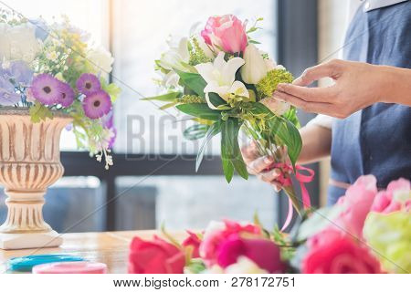 Female Florist At Work Using Arranging Making Beautiful Artificial Bouquet Vest At Flower Shop, Busi