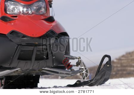 Red Snowmobile In Winter Mountains Close Up